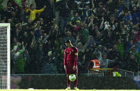 Charles McQuillan/Getty Images. Ronaldo slumps in dejection as Northern Ireland score to go 2-1 up against Portugal at Windsor Park, Belfast. Picture Charles McQuillan. Finalist in the Genesis Imaging Regional Photographer of the Year category at The Picture Editors Guild Awards 2015.