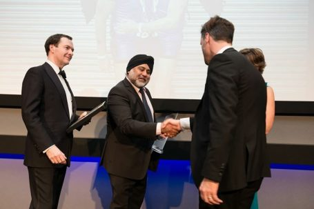 Charles McQuillan receiving award from Ken Sethi and George Osborne - UKPEG Awards 2017